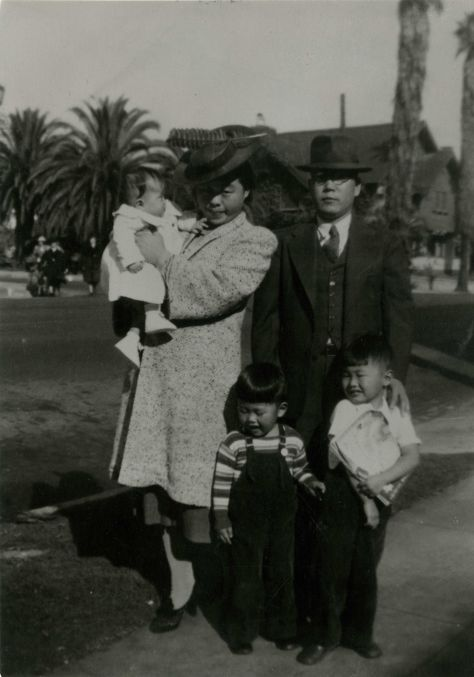 George Takei's family in the Wilshire district of Los Angeles, photo taken around 1940. From left to right: George's baby sister Nancy is held by George's, mother Fumiko Emily Takei. To their left is George's father, Takekuma Norman Takei. George's brother Henry is in the middle and all the way on the right right is George.