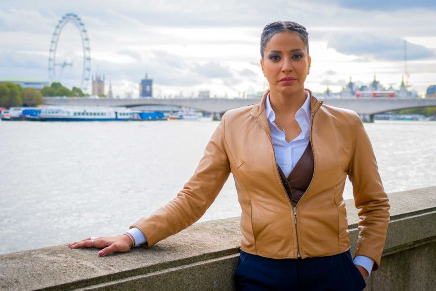 A woman in a tan leather jacket