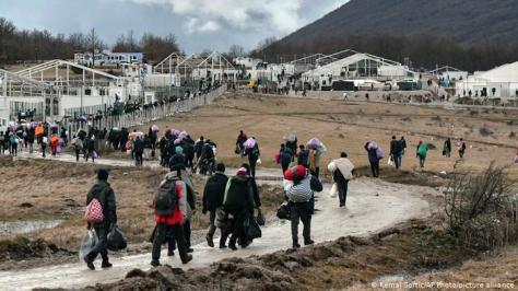 Migrants walk back to the Lipa camp