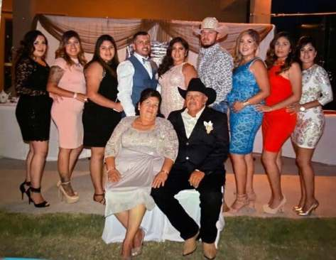 Jose Garcia, who died on Dec. 15 from complications of Covid-19, with his wife and children.