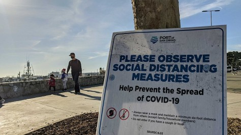 A sign reminding people of socially distance during the COVID-19 pandemic at ...