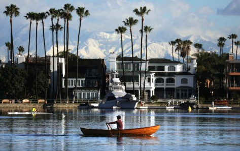 The snow-capped mountains are within view of the Peninsula in Long Beach on Tuesday.