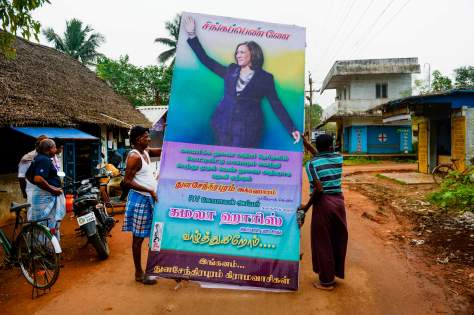 Residents prepare to put up a hoarding with a photo of US Vice President-elect Kamala Harris at her ancestral village of Thulasendrapuram in the southern Indian state of Tamil Nadu on January 20, 2021.