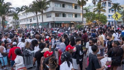 A large crowd of people participate in a party during spring break in Miami Beach