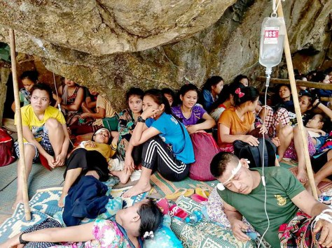 Karen villagers, injured in government air strikes in late March, take shelter and receive medical care in the jungle near the village of Day Pu No in Hpa-pun in eastern Myanmar's Karen State. (Free Burma Rangers)