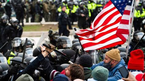 Capitol rioter who 'hit cops with fire extinguisher' bused to DC by Turning Points USA