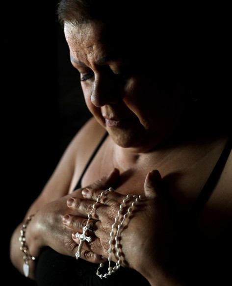 Blanca Lopez holds a rosary.