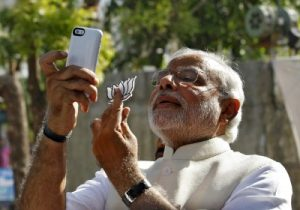 Narendra Modi takes a 'selfie' with a mobile phone, Ahmedabad, 30 April 2014 (Photo: REUTERS/Amit Dave).
