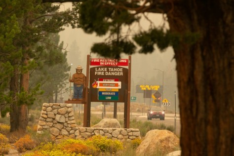 Highway 50 remains closed due to the Caldor fire as smoke and ash fill the air in the Lake Tahoe Basin.